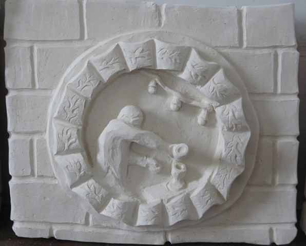 A clay relief of a faux brick wall with decorative wreath, depicting a bartender/alchemist pouring spirits from a bottle.