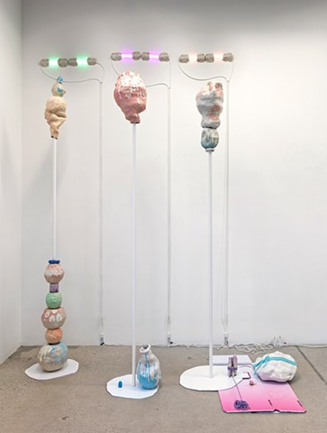 installation view showing: Pull eyebrow I (phosphorescent green), Pull eyebrow II (fuschia), Pull eyebrow III (salmon pink) on Bokashi Island...