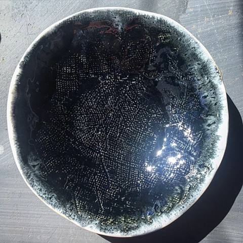 Blackened steel glaze on porcelain