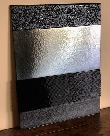 Textured glass portrays the night.