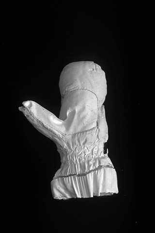 plaster casts of lost mittens, photographs, consumerism, mapping
