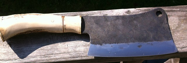 "A sturdy through tang and 1/4""+ thick spine make this as much a hatchet as a knife"