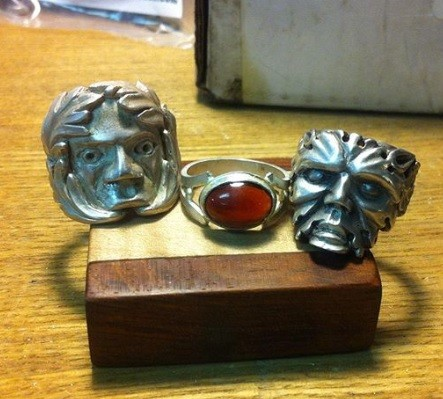 Greenman rings carved in jewelers' wax and cast in sterling silver, and a star garnet ring in sterling.