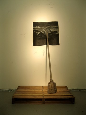 broom on a pallet that holds up a drawing of a generic mountain landscape, romanticism, individualism