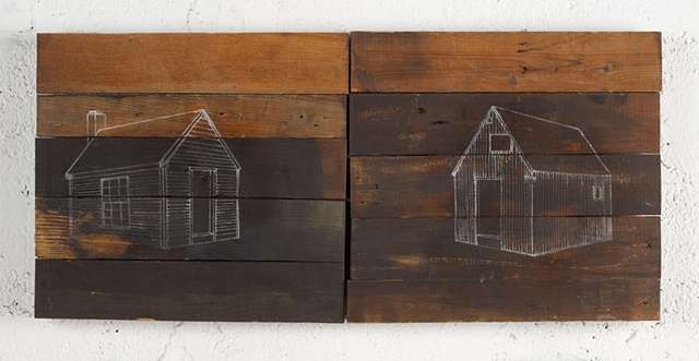 Two identical wooden shacks stand next to each other, one echoing the other in dimension, style and construction.  The two structures serve as a concept of where society draws a line between genius and madness, in this case, indistinguishable.  It is only