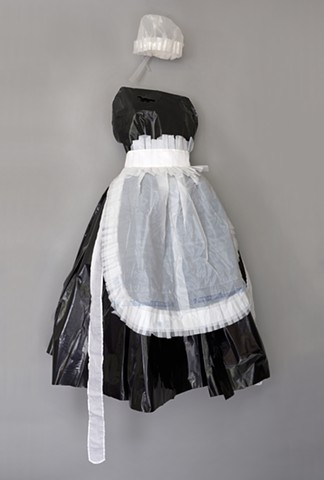 Mixed media maid's uniform sewn from Wal-Mart bags by Shara Rowley Plough.