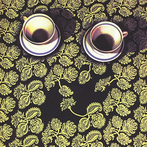 2 cups on patterned tablecloth, pattern alludes to tongues