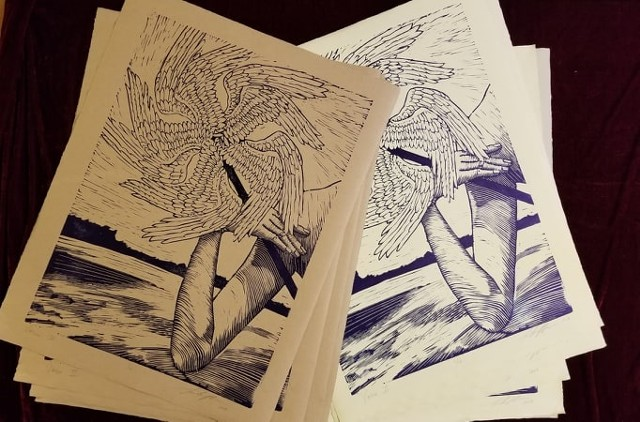 linocut with woman's art holding angel wing pinwheel again river landscape black & white print