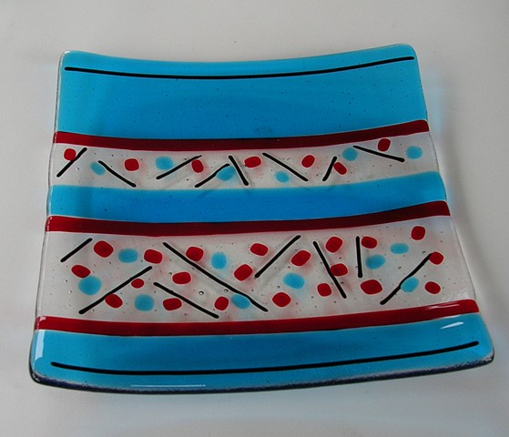 fused glass appetizer plate in turquoise with red and black accents
