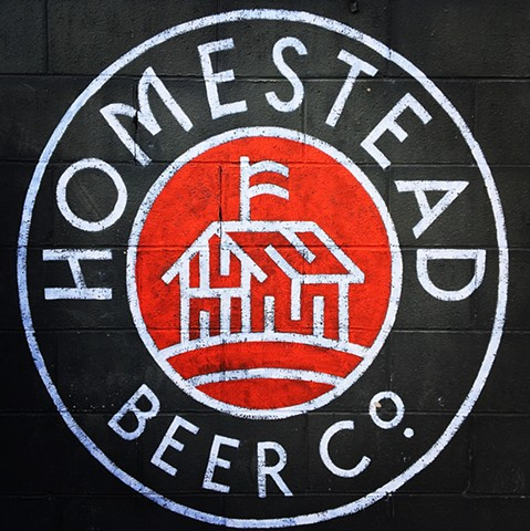 Hand painted logo for Homestead Beer Co. at Rehab Tavern Columbus Ohio