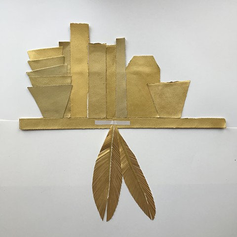 gold shelf with feathers