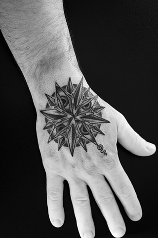 Tattoo by Mikel - Kelowna B.C. Canada. Compass of compassion