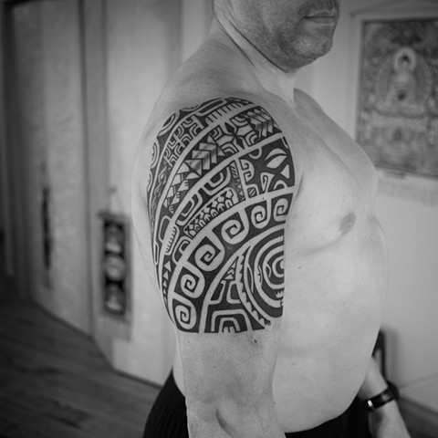 Marquesian inspired tribal half sleeve