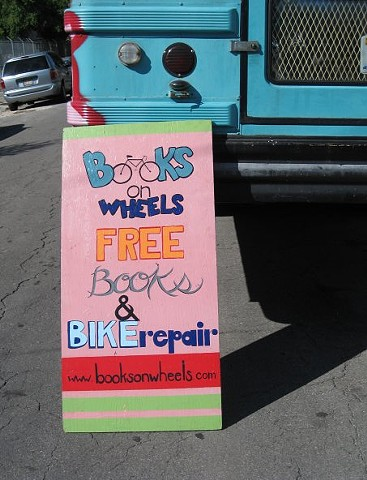 Books On Wheels Sandwich Board