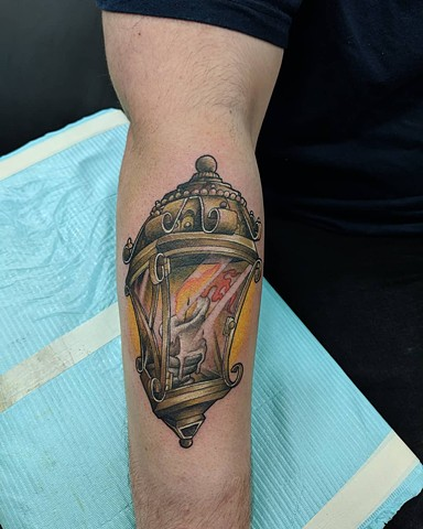 Lantern Arm Tattoo by Kevin Sherritt Color Black Gold Tattoo Co.
