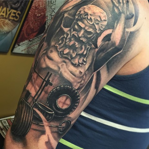 Fitness Inspired Atlas And Weights Tattoo By Sarah Michelle Black And Grey Black Gold Tattoo Co