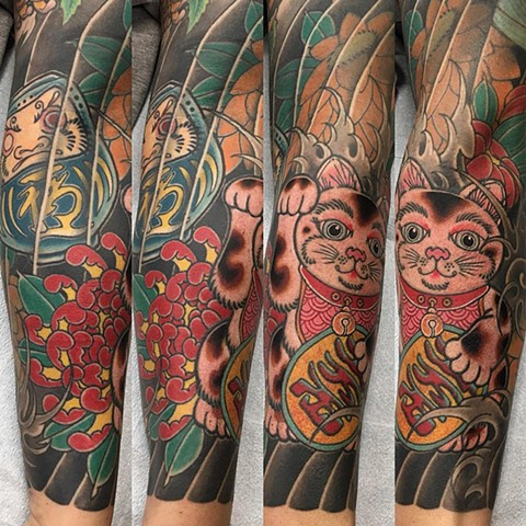 Daruma Doll And Lucky Cat With Chrysanthemum Tattoo By Guka Color Black Gold Tattoo Co