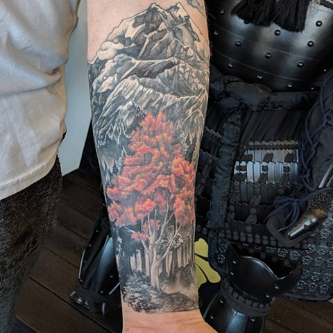 Mountain Landscape with Trees Arm Tattoo by Kevin Sherritt Black and Grey with Color Black Gold Tattoo Co.