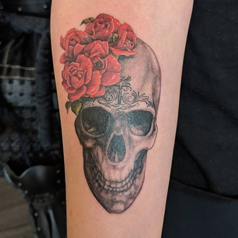 Skull with Flowers Arm Tattoo by Kevin Sherritt Black and Grey with Color Black Gold Tattoo Co.