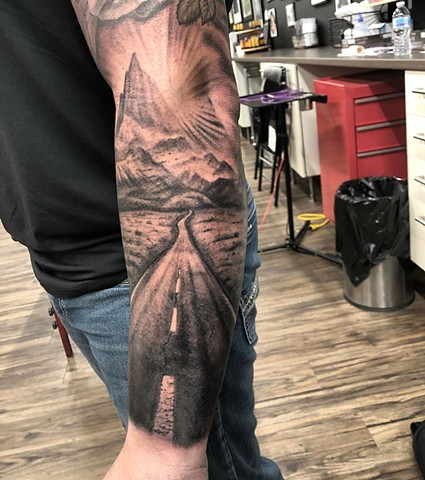 Road and Mountain Scenery Tattoo By Steve Hayes Black And Grey Black Gold Tattoo Co