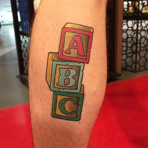 Letter Blocks Tattoo By Chris Benson Color Black Gold Tattoo Co