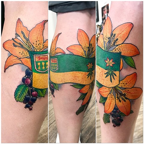 Saskatchewan Flag With Lilies Tattoo By Jess Alther Color Black Gold Tattoo Co