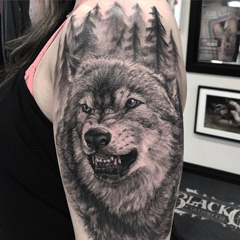 Wolf and Forest Scenery Tattoo By Steve Hayes Black And Grey Black Gold Tattoo Co