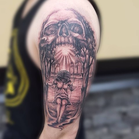 Skull With Girl On A Swing Tattoo By Kevin Sherritt Black And Grey Black Gold Tattoo Co.