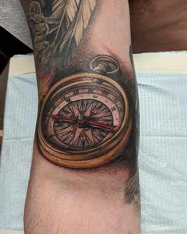 Compass Arm Tattoo by Kevin Sherritt Color Black Gold Tattoo Co.