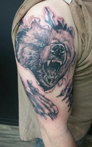 Bear Tearing Through Skin Tattoo By Ashley Hoff Black And Grey Black Gold Tattoo Co
