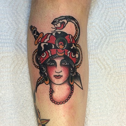 Traditional Woman With Snake Tattoo By Spencer Evans Color Black Gold Tattoo Co