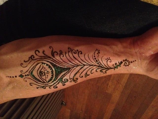Henna on mans forearm
