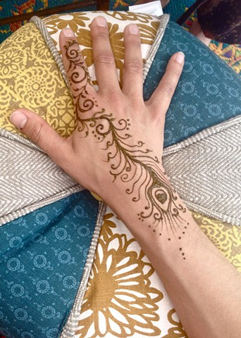Henna hand with Peacock feather trail
