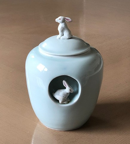 wheel thrown, celadon jar with porcelain bunny figures