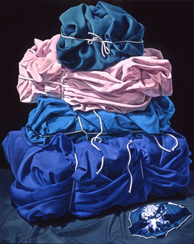 """Relative Mass"" by Pamela Sienna 20"" x 16"" oil painting on panel, stack of cloth wrapped and bound, scrap of paper with bomb image, still life, contemporary realism"