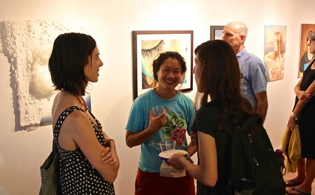 Artist, Emily Burns and friends mingling