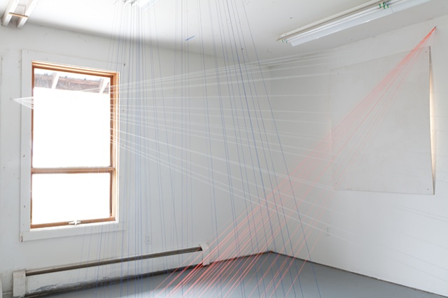 Neon-orange thread traces the sunlight as it entered the space, while the white and blue thread maps the mist and rain outside the window.