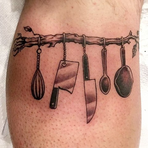 Chef Utensils Hanging on a Branch