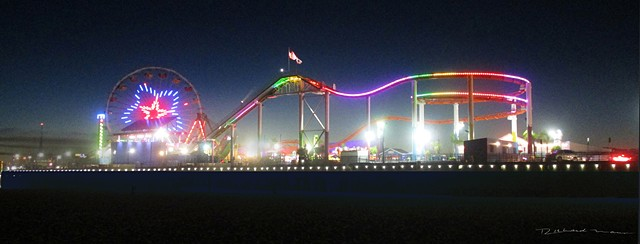 Santa Monica Pier in the Evening with rides  lights and the beach