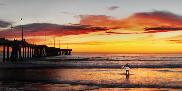Venice Beach Ca.  surfing  sunset  at the Venice Ca. Pier