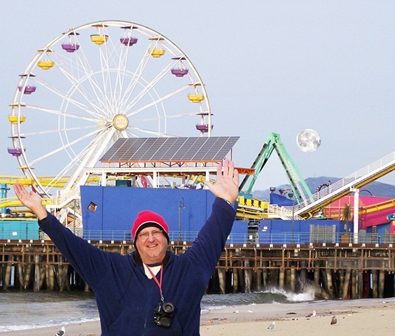 My profile image and biography as the Moon sets over the Malibu Mountains and the Santa Monica Ca. Amusement Pier in the background