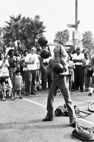 Venice Beach Ca. Side show bowling ball juggller