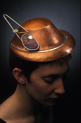 copper, hollow formed hat with removable silver and enamel brooch