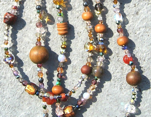 Detail, Buddha beads harmony in orange
