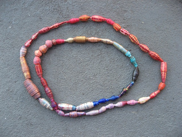Handmade paper beads, magenta stripes (detail)