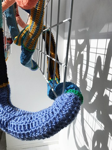 Crocheted yarn window installation