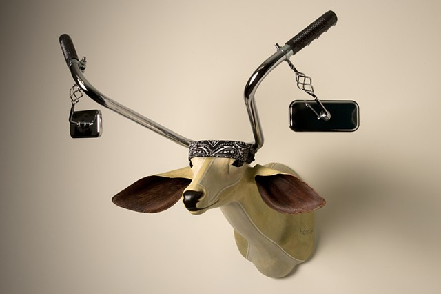 deer head with lowrider bike bicycle handle bars.