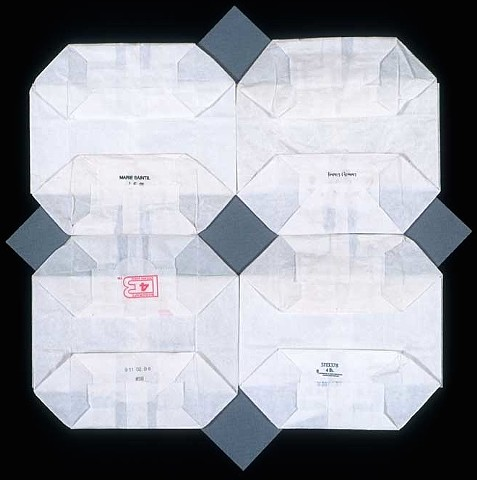 "I wanted to try a ""quilt "" square composition with white bags by Laura Evans"