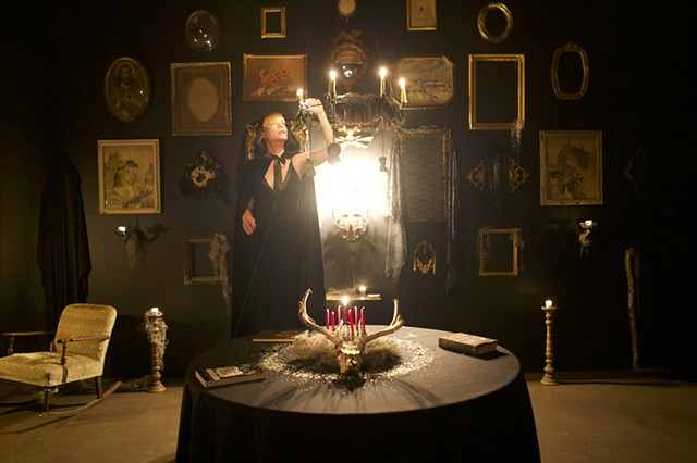 Artist Lighting Candelabra in Seance Room