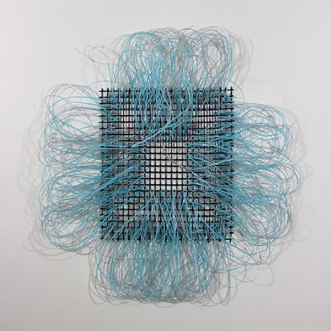 blue plastic wall hanging by Jose Santiago Perez